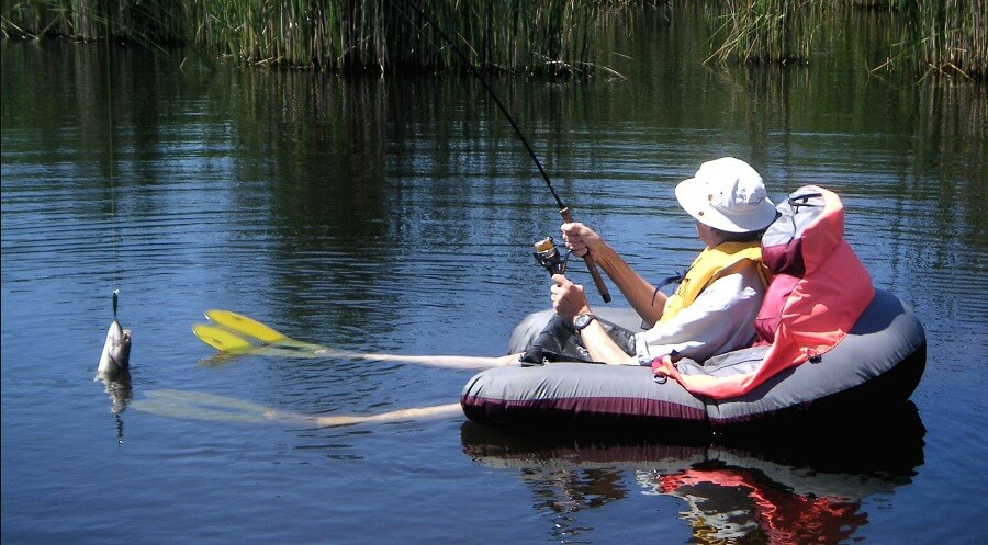 a man fishing on a fishing float tube