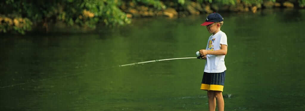 a kid using a fishing pole